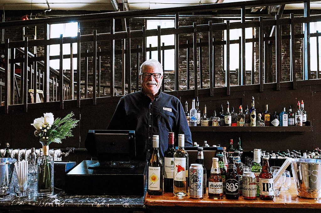 Popular portable bars at Miners Foundry, such as this one staffed by beloved bartender Eric Fjeldheim, are being replaced with a new permanent bar offering enhanced products and services.