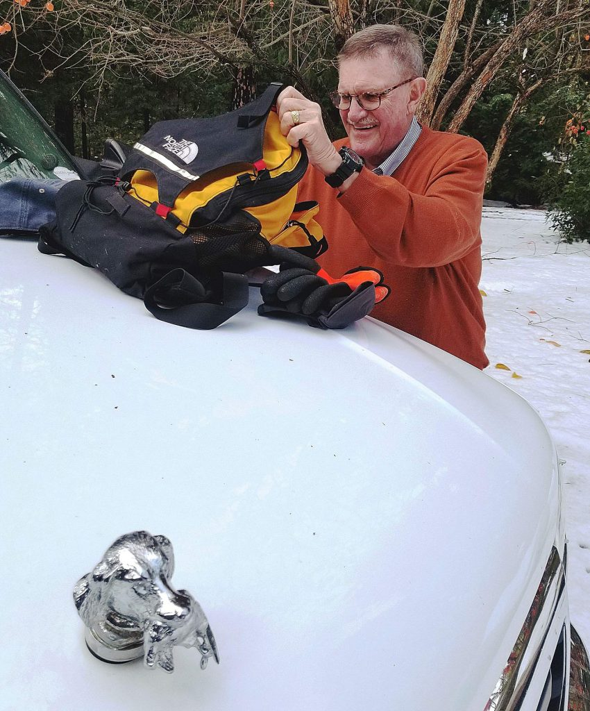 Bill Drown was always prepared, as shown here checking his bag packed with supplies needed when his Grass Valley Police Department volunteer skills were requested for an extended time. He also planned ahead to honor his loved ones even after his death in March.
