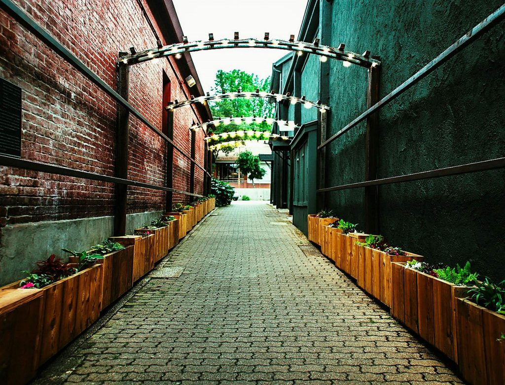 A downtown Grass Valley alley, dedicated to US Ambassador J. Christopher Stevens, now boasts lighted arches and planter boxes filled with colorful flowers.