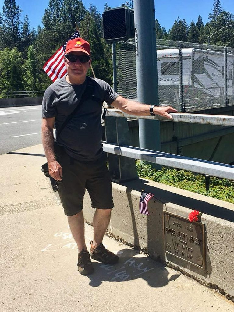 Doug Jensen stands at the plaque on Empire Street, Grass Valley, which commemorates his father, Bruce Allen Jensen