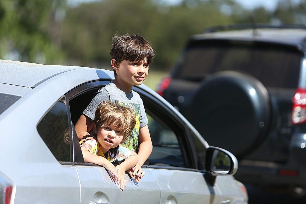These Tall Pines youngsters get a better view of the horses during the drive-thru tour.