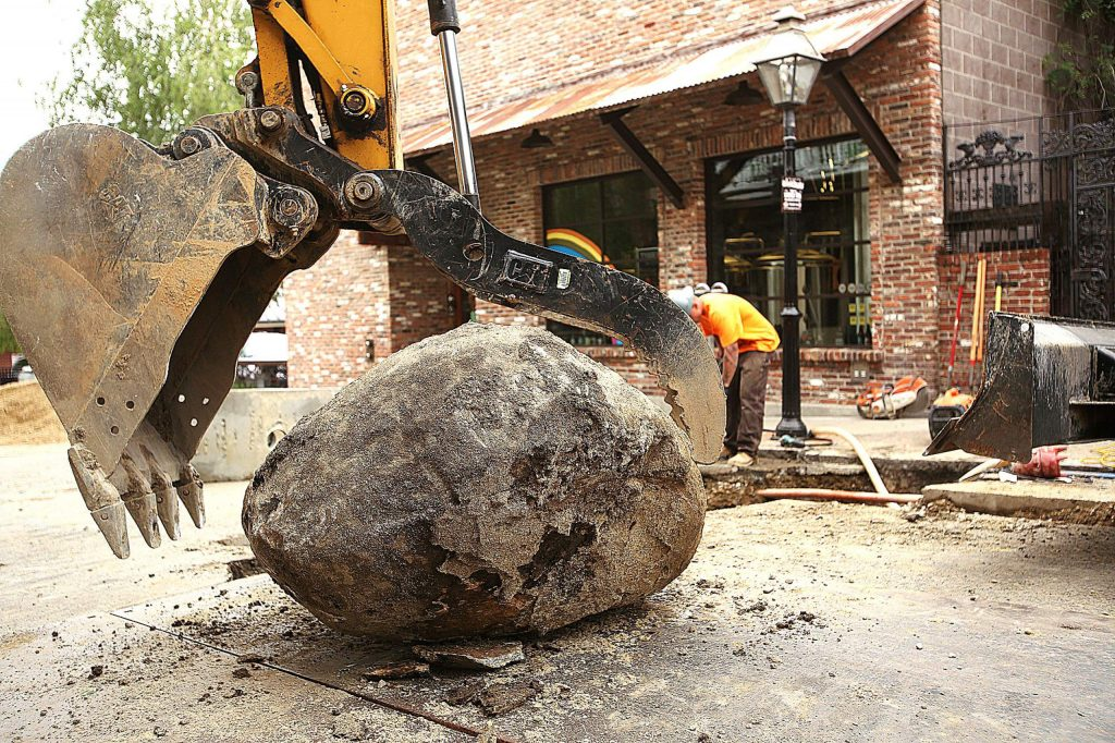 Contractors removed a large boulder from the ground beneath Commercial Street during sewer line replacement last week in downtown Nevada City.