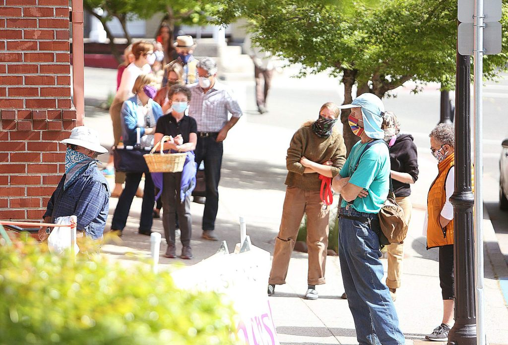 A line stretches out of the Nevada City Farmer's Market during Saturday's return, with COVID-19 social distancing measures put into place. Customers were asked to keep six feet distance from one another and were limited to about 17 people in the market at a time.