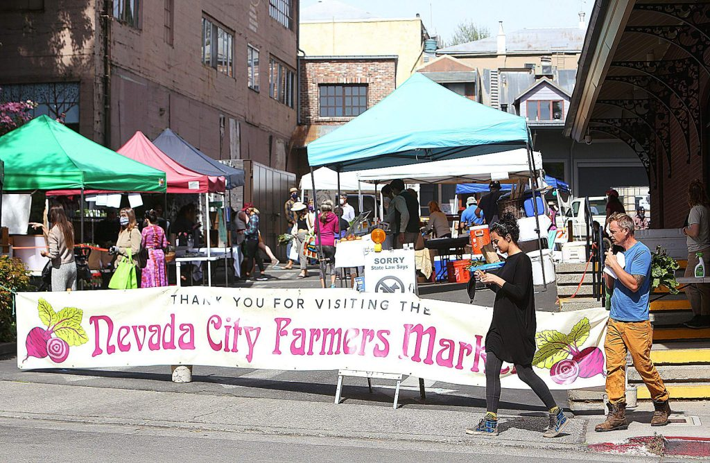 The Nevada City Farmer's Market has returned fo the Three Forks parking lot in downtown Nevada City, with some COVID-19 precautions put into place.