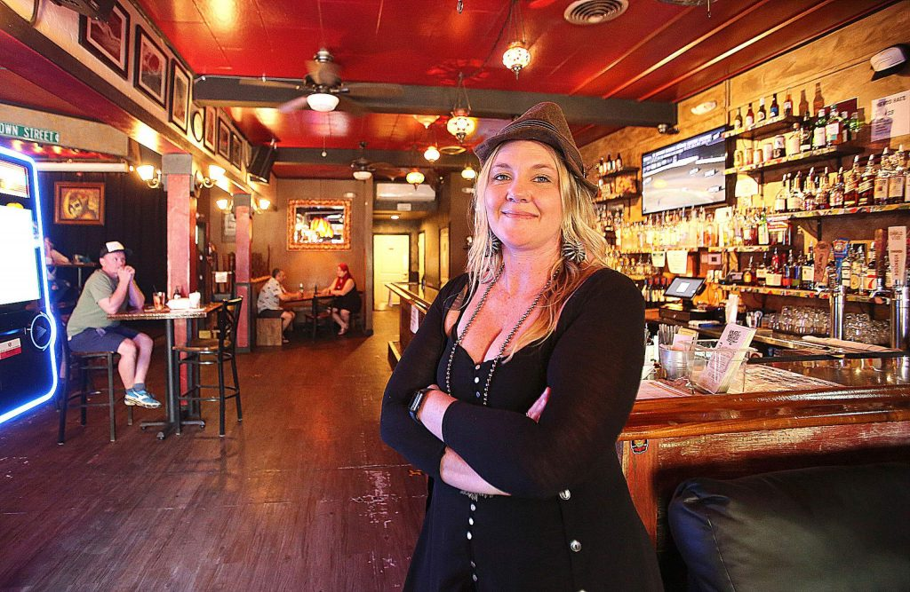 Crazy Horse Saloon and Grill owner Kate Anderson is grateful to be open and serving meals, but can't wait to be allowed to operate in the bar's full capacity which includes serving hard alcohol and live music.