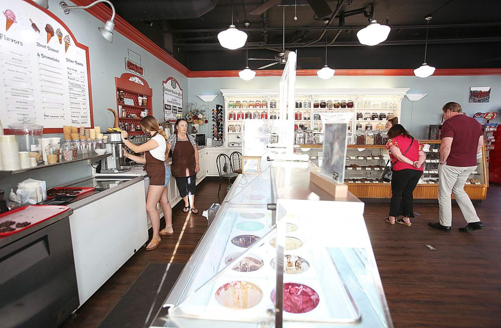 Weekend day trippers from the Sacramento region peruse the items and make orders Saturday from Nevada City Chocolate Shoppe which also recently reopened their doors to customers.