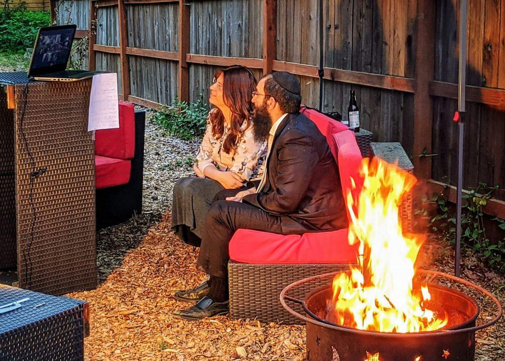 Rabbi Nochum and Chyena Yusewitz host their annual Community Bonfire at Chabad of Grass Valley on Zoom, to celebrate the Jewish Holiday of Lag Ba'omer. Photo taken May 12.