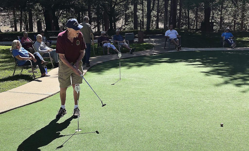 Ed Smith during a head-to-head match at the Ponderosa Pines putting green on May 8.