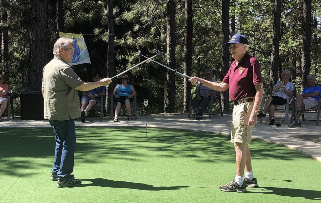 Ed Smith, right, and Tom Vanderleun congratulate each other after a close match at the Ponderosa Pines putting green.