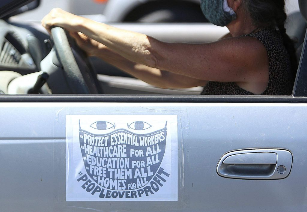 About two dozen people took part in a May Day protest, focusing on the millions of Americans who have lost jobs and families suffering the effects of the pandemic. Vehicles adorned in signage drove up and down Sutton Way Friday morning.