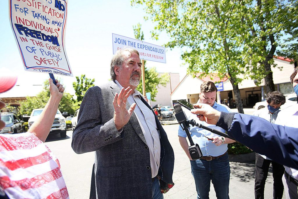 California U.S. Rep. Doug LaMalfa addresses members of the media during a ReOpen Nevada County rally Friday in downtown Grass Valley. The event attracted about 100 people, some of them area business owners who are choosing to reopen without official sanction from government officials.