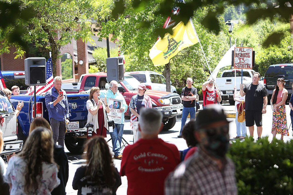 About 100 people and dozens of speakers attended Friday's ReOpen Nevada County rally in Grass Valley.