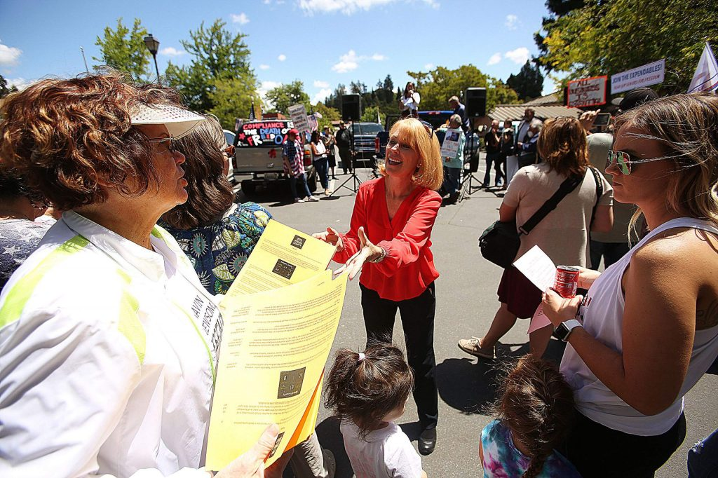 ReOpen Nevada County representatives pass out literature and promote more pushback on local officials regarding reopening the county.