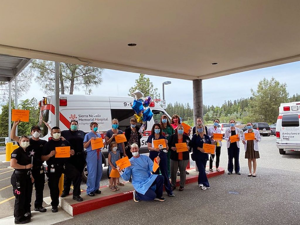 Sierra Nevada Memorial Hospital employees, physicians and ambulance staff offer a fond farewell and encouragement as the remaining COVID-19 patient is discharged.