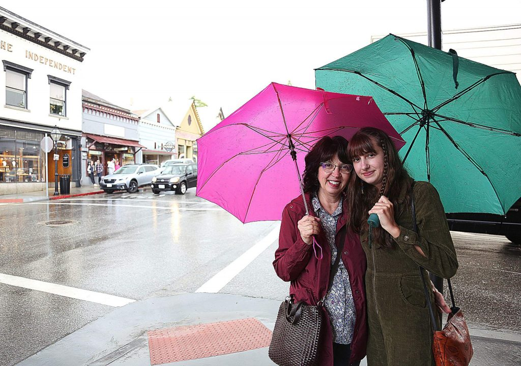 Grass Valley's Terri Sam and Sierra Slaton didn't get caught out in Nevada City's thunderstorms Saturday without their umbrellas.