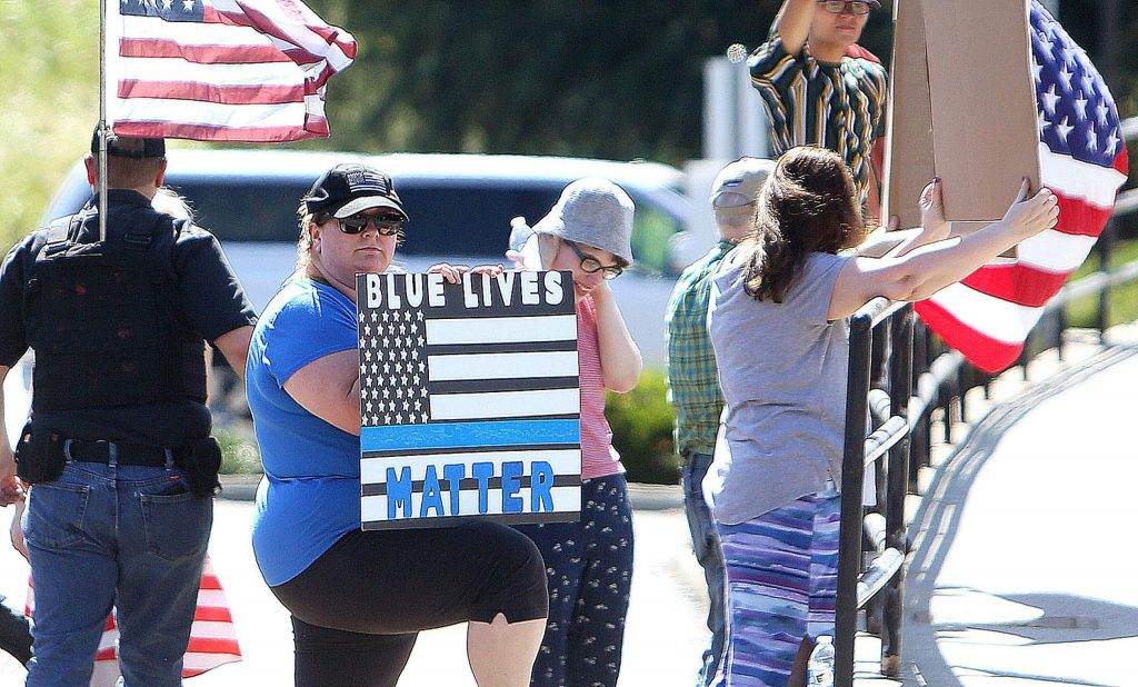 About a dozen people gathered Wednesday at the Sutton Way and Brunswick Road intersection in Grass Valley to show their support of law enforcement and their disdain of other communities' calls to defund the police. The group plans to hold more Back the Blue rallies this Friday and Saturday.