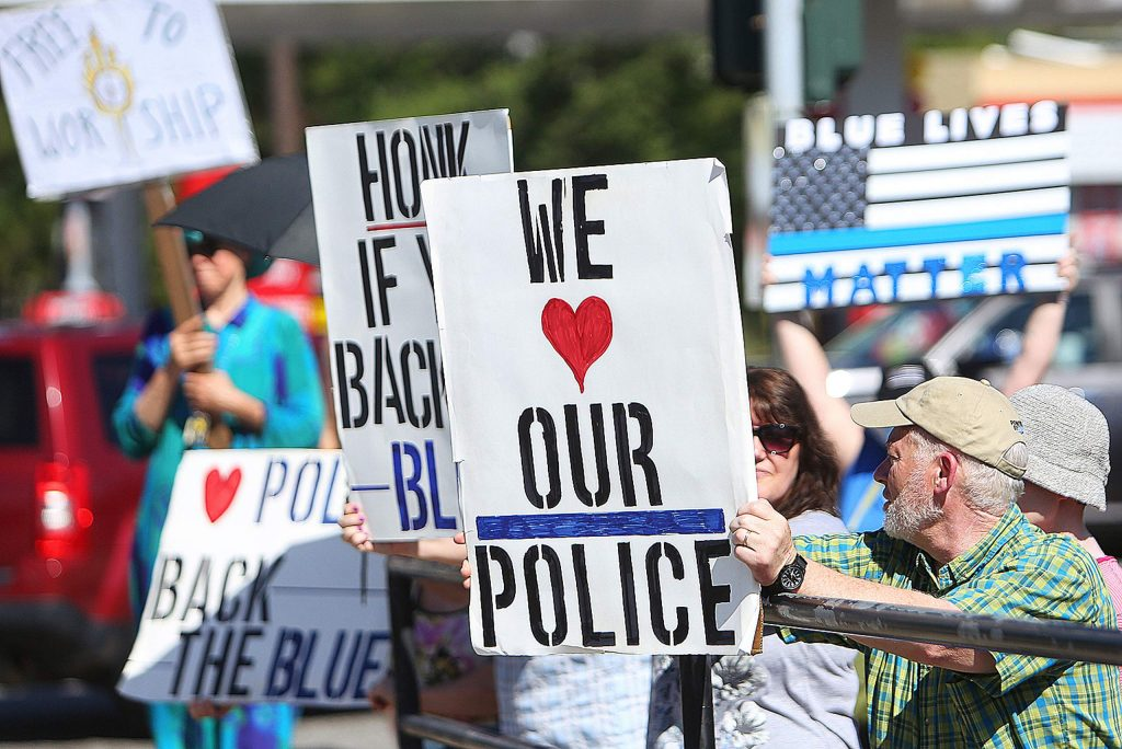 Peaceful protesters in opposition to recent calls to defund police departments show their support for law enforcement Wednesday at the intersection of Sutton Way and Brunswick Road in Grass Valley. The group plans to hold another rally here Friday and one in downtown Grass Valley Saturday afternoon.