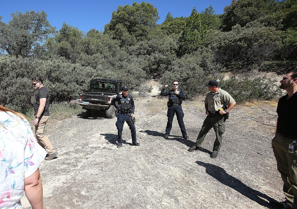 Nevada City police officers plan to lead members of the Hospitality House Home team into the Sugarloaf Mountain homeless encampments last week in Nevada City.