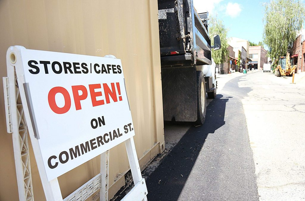 Signs placed along Commercial Street in downtown Nevada City let people know that the businesses are open despite construction material lying about.