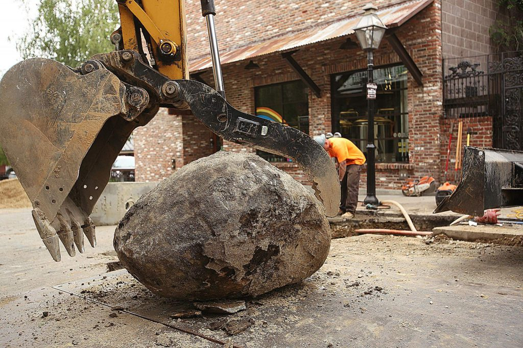 A large boulder is removed from beneath Nevada City's Commercial Street last month after the boulder caused issues with the sewer main replacement project.