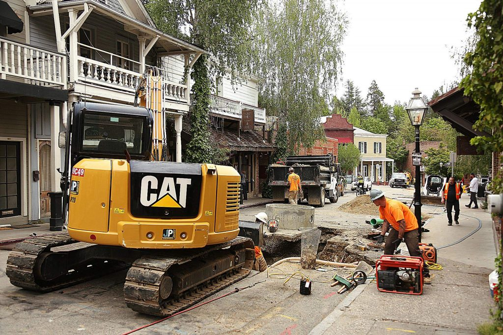 Construction equipment sits in the middle of Commercial Street in downtown Nevada City last month as contractors work to repair a sewer main line.