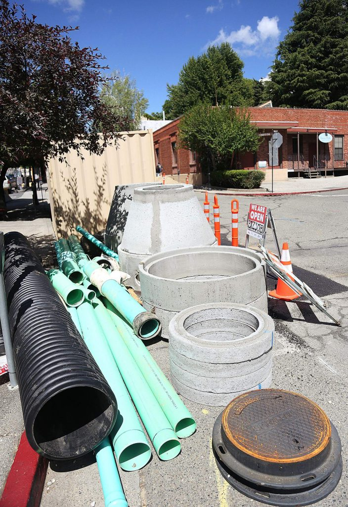 New road construction materials await to be used along the side of Commercial Street in downtown Nevada City Tuesday. The sewer main replacement project has gone past its due date.