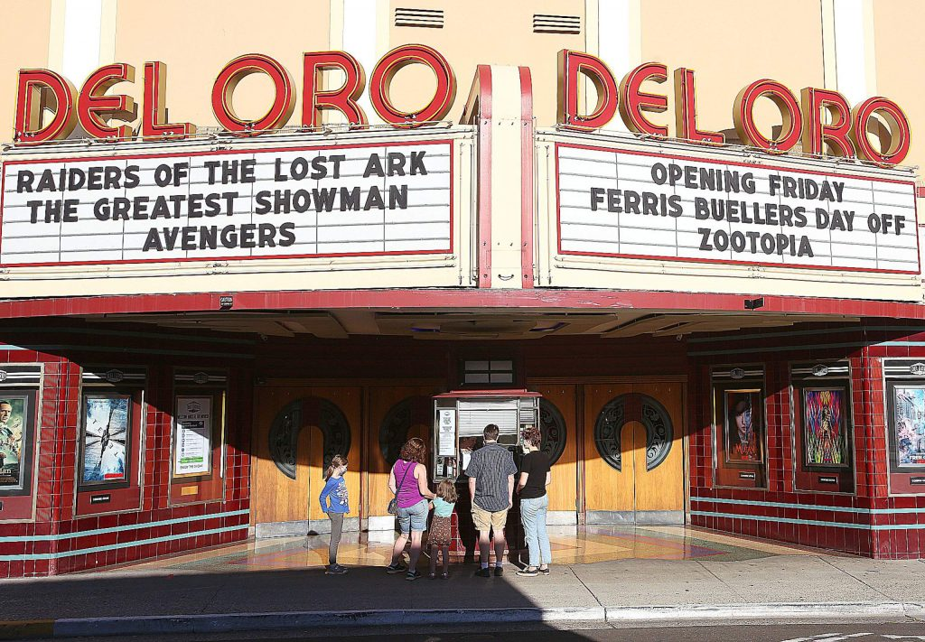 A family purchases their tickets from the Del Oro Theater box office for a show Saturday evening. The downtown Grass Valley Theater began showing films again Friday.