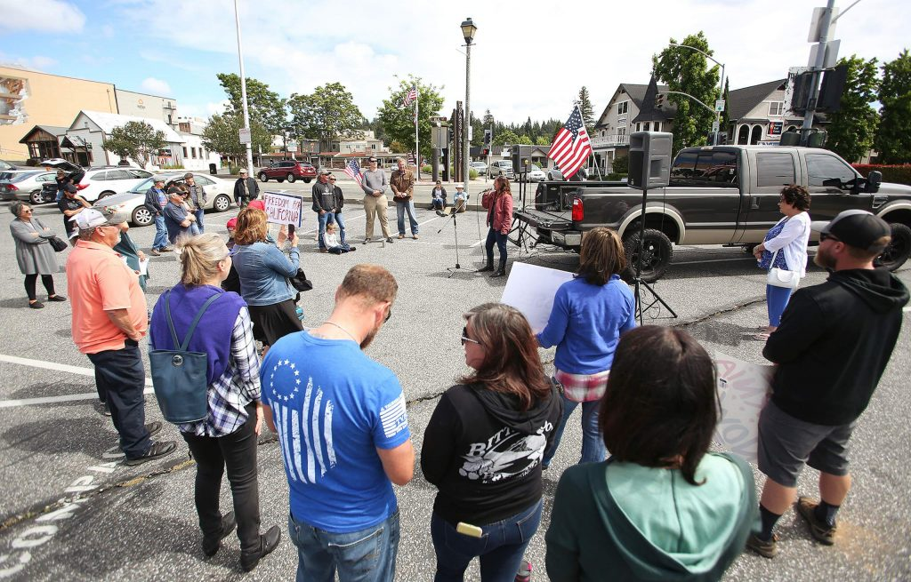 Protesters gathered Saturday morning at corner of Neal and South Auburn streets to object to the cancellation of the Nevada County Fair and the shuttering of other remaining businesses that have yet to be allowed to reopen.