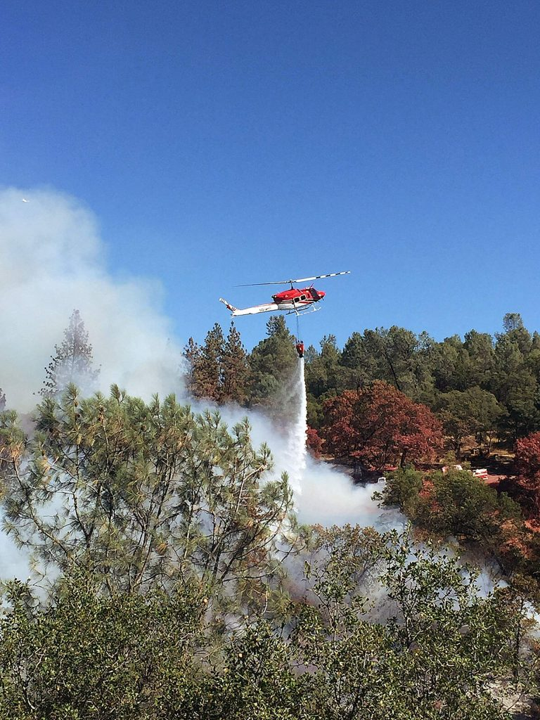 Images of Cal Fire officials fighting a fire in Lake Wildwood. Cal Fire public information officer Mary Eldridge said the fire was a good reminder for people to practice evacuating the area during a wildfire.