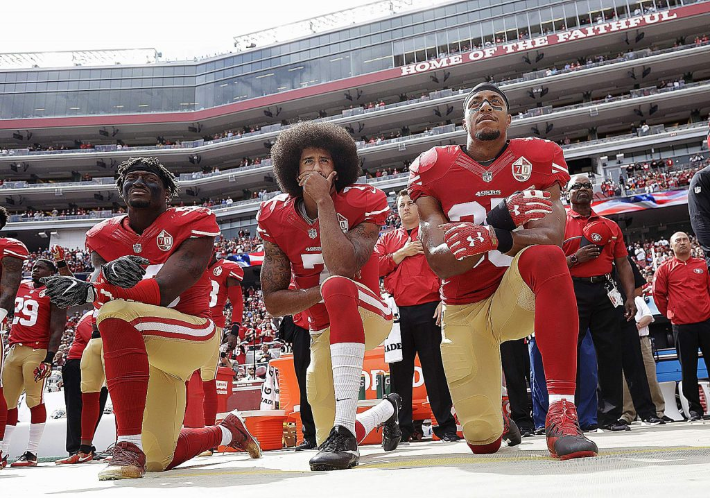 When Colin Kaepernick, middle, took a knee during the national anthem to take a stand against police brutality, racial injustice and social inequality, he was vilified by the league and fans who considered it an offense against the country, the flag and the military. Nearly four years later, the NFL has apologized for not listening to players who peacefully protested.