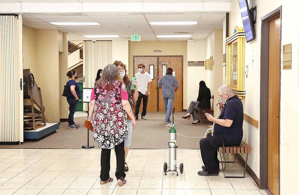 People wait to be allowed to enter the courtroom at Nevada County Superior Court in downtown Nevada City Wednesday June 17 before the first criminal trial to be held in months.