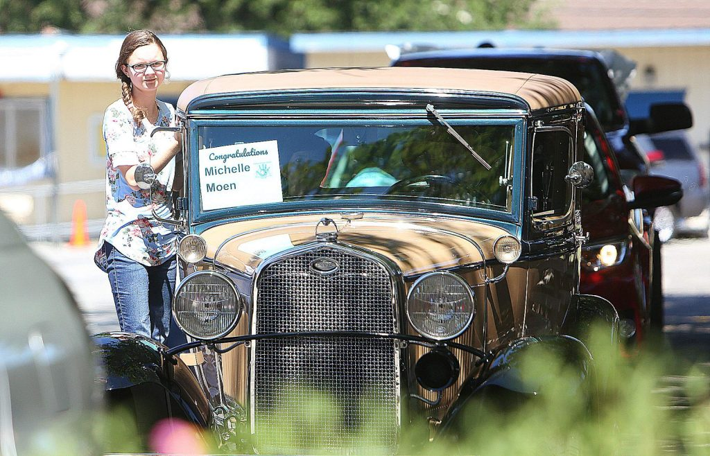 Michelle Moen arrives in style to her eighth grade graduation from Ready Springs Elementary in Penn Valley on a 1931 Ford. A drive-thru ceremony involving the Nevada County Sheriff's Office, Cal Fire Station 20, Penn Valley Rotary, and the Penn Valley Rodeo Association was set up to help the students graduate.