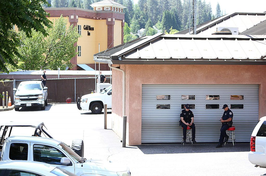 Grass Valley police officers keep tabs on the large Black Lives Matter protest from behind the Grass Valley Police Department on South Auburn Street June 6. The officers kept a minimal presence yet remained available if needed.