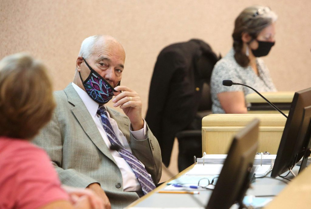 Nevada County Supervisor Dan Miller adjusts his mask during Tuesday morning's Board of Supervisors meeting, the first publicly held supervisors meeting since the coronavirus shutdowns in mid-March.