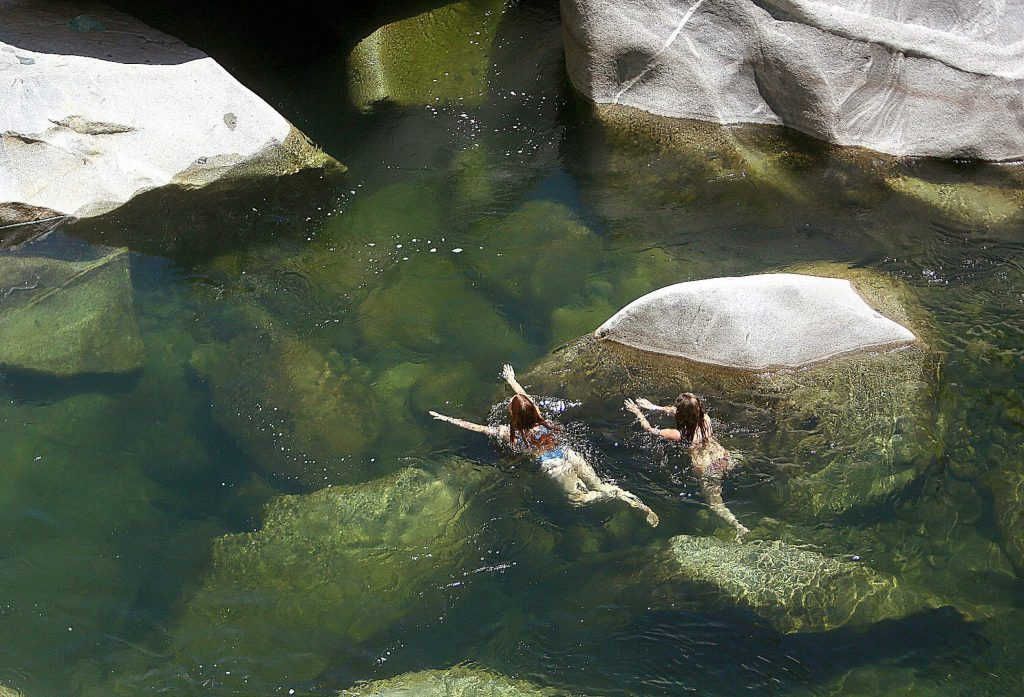 A pair of swimmers take to the waters of the South Yuba River under the Highway 49 bridge last week when temps hit the upper 90s.