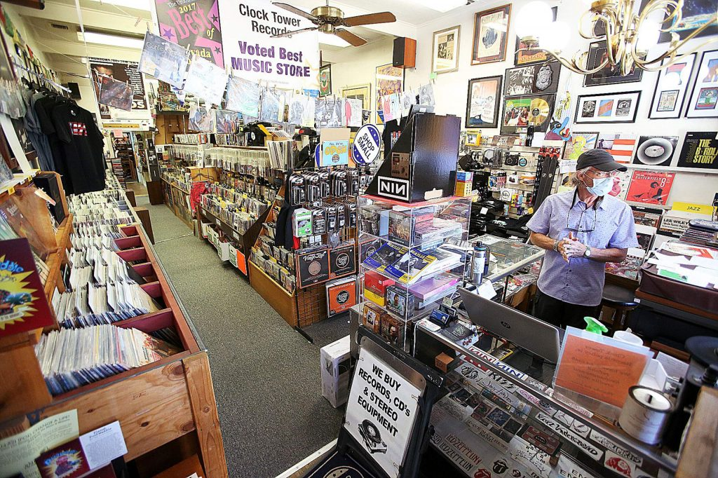 Curt Smith of Grass Valley's Clock Tower Records looks out from the front window of his downtown music store's location, under the clocktower at Mill and Main streets. Smith has decided to close his store and offer it for sale.