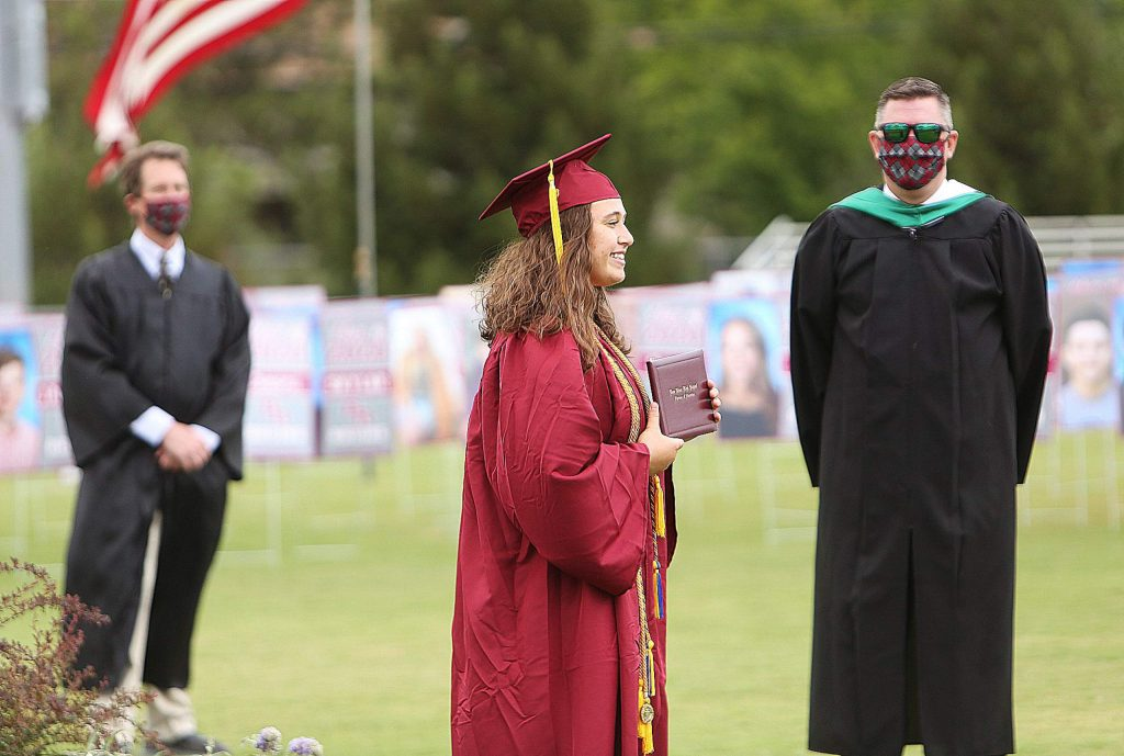 A Bear River graduate poses for a picture following her graduation given by appointment last month at Bear River's High School's stadium.