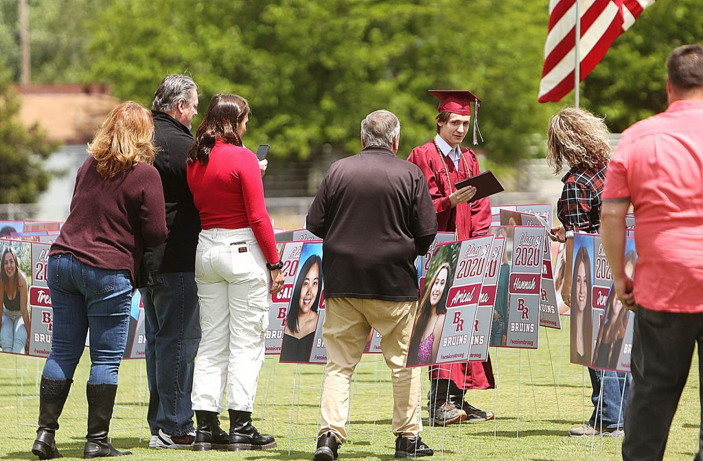 Family surround a graduate following their walk through promotion ceremony May 19 at Bear River High School.