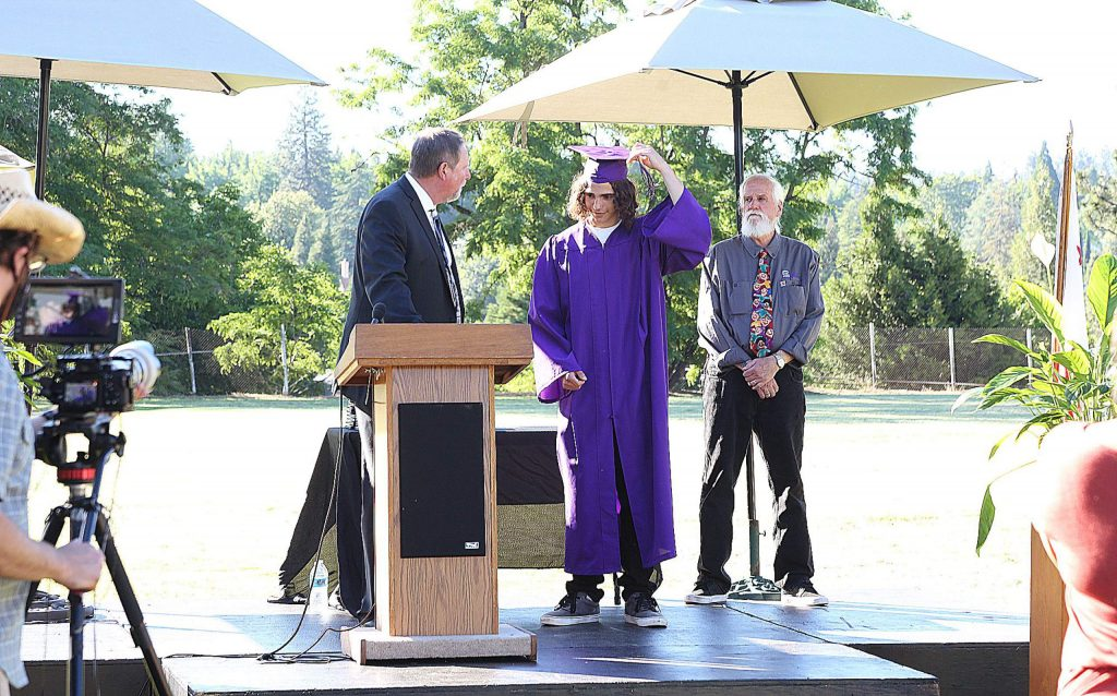 A Silver Springs High School graduate moves his tassel from one side of the cap to the other, signifying his promotion from the 12th grade.