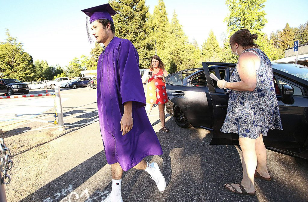 A Silver Springs High School graduate leaves the vehicle and heads to the stage during last week's ceremony.