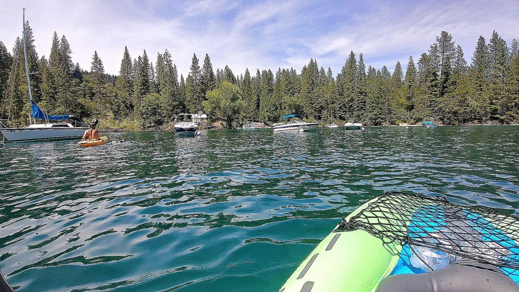 Kayakers take to the waters of Scotts Flat Reservoir. While the day use and camping areas of the lake are still closed, folks can still utilize the docks to launch boats, kayaks, and paddle boards.