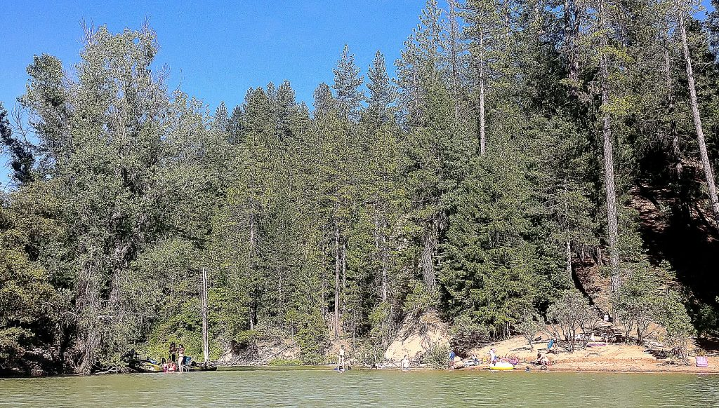 Cascade Shores residents take to the waters of Scotts Flat from private locations during the weekend's heat. Temperatures are expected to stay high throughout the next week.