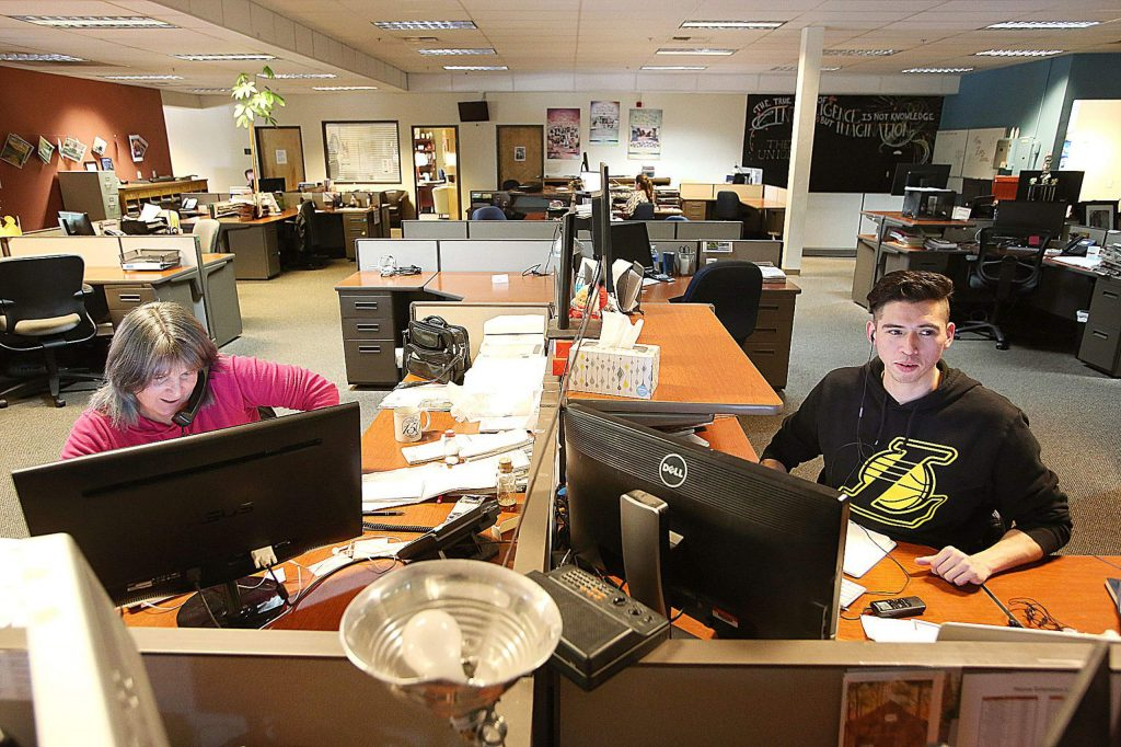 The Union reporters Liz Kellar and John Orona work from their desks at The Union's offices at 464 Sutton Way in Grass Valley. In this article, employees of The Union past and present tell their stories of life in Nevada County and the moment America is in right now.
