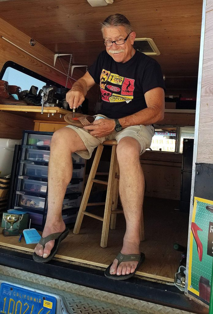 Frank Pfaffinger works out of his repair truck on the street near his store's previous location at 117 Argall Way in Nevada City. Pfaffinger launched a mobile business last month after the coronavirus lockdown forced him to close the Nevada City Shoe Repair shop he had operated for 33 years.