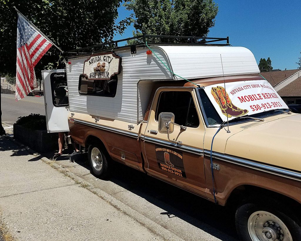 Business is brisk at the mobile location of Nevada City Shoe Repair along Argall Way.