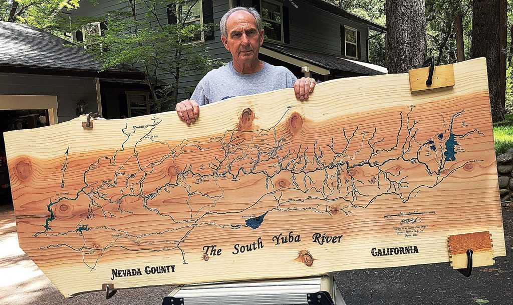 Pete Brost of Nevada City created a detailed map of the South Yuba River watershed on a large slab of Sequoia wood.