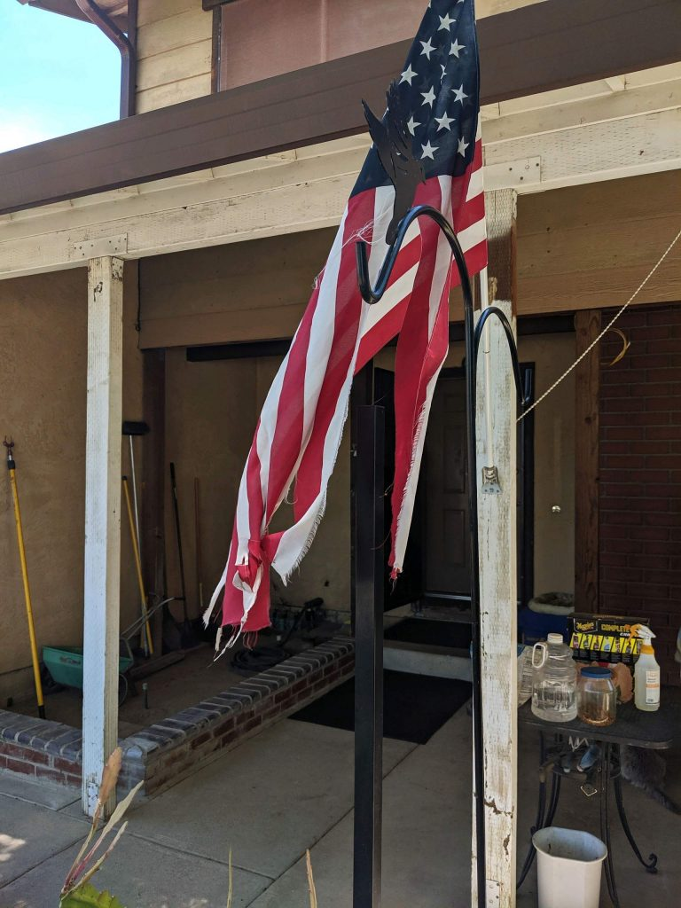 An elderly man was unhappy he couldn't replace his tattered American flag because he suffers from severe arthritis … until Bill Hunting, an employee of Byers Leafguard Gutters, replaced the flag for him.