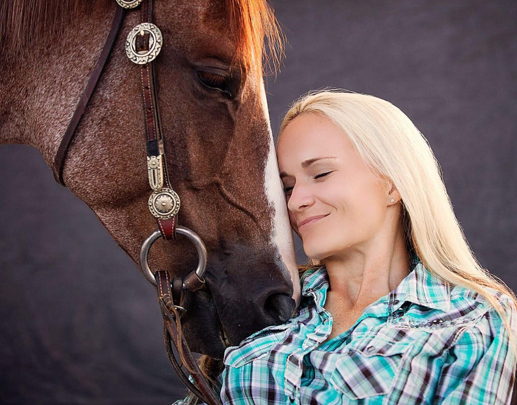 Sarah Davis grew up riding, competing, herding cattle, branding, and anything else that can be done on or around horses.
