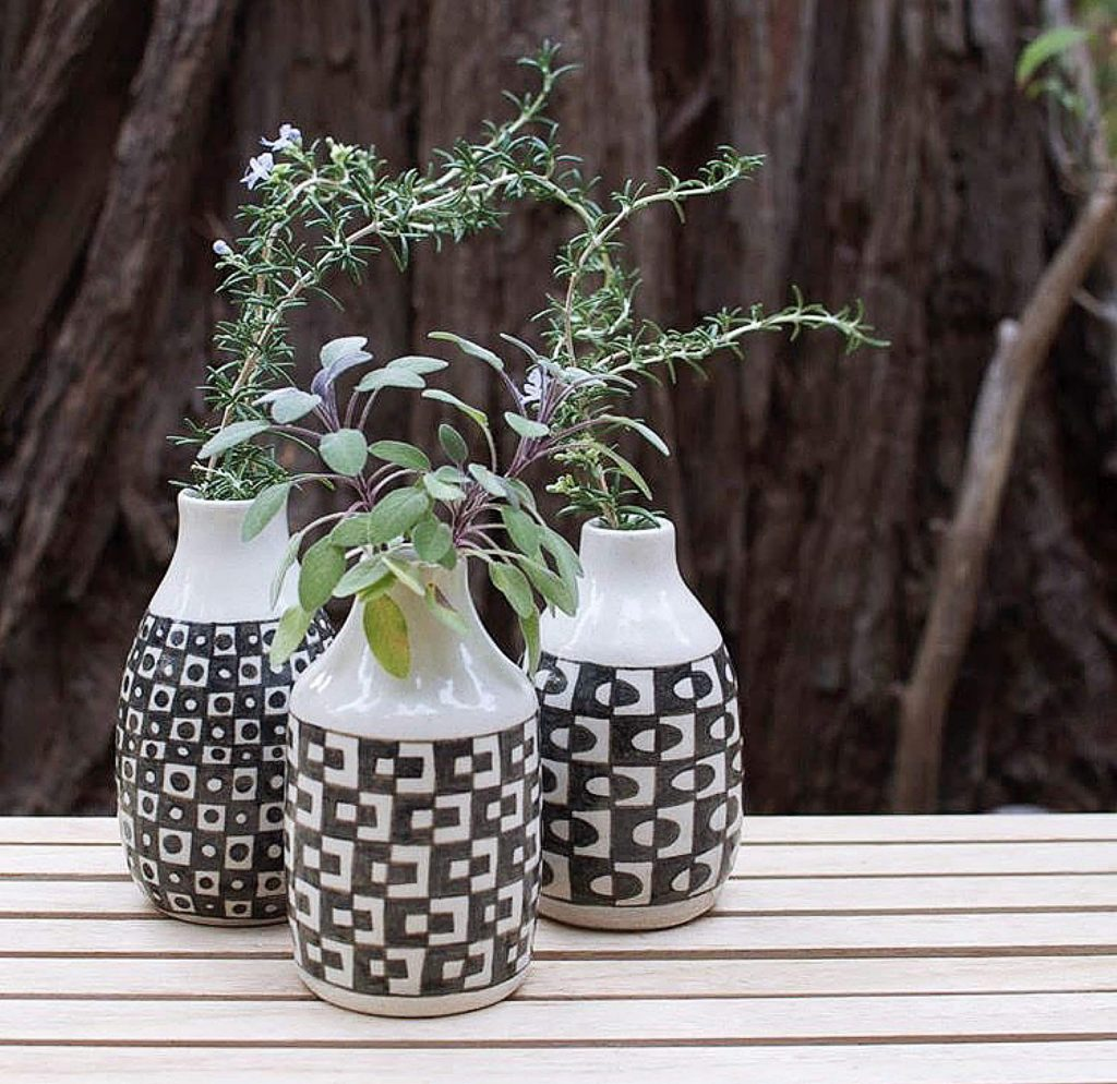 Vases such as these are hand-crafted and painted by artist Stephanie Adams.