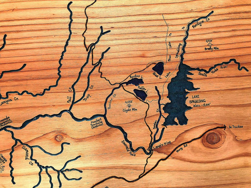 From Lake Spaulding to Lake Englebright, Pete Brost routed waterways into the wood and inked them in blue, emerald, and turquoise.